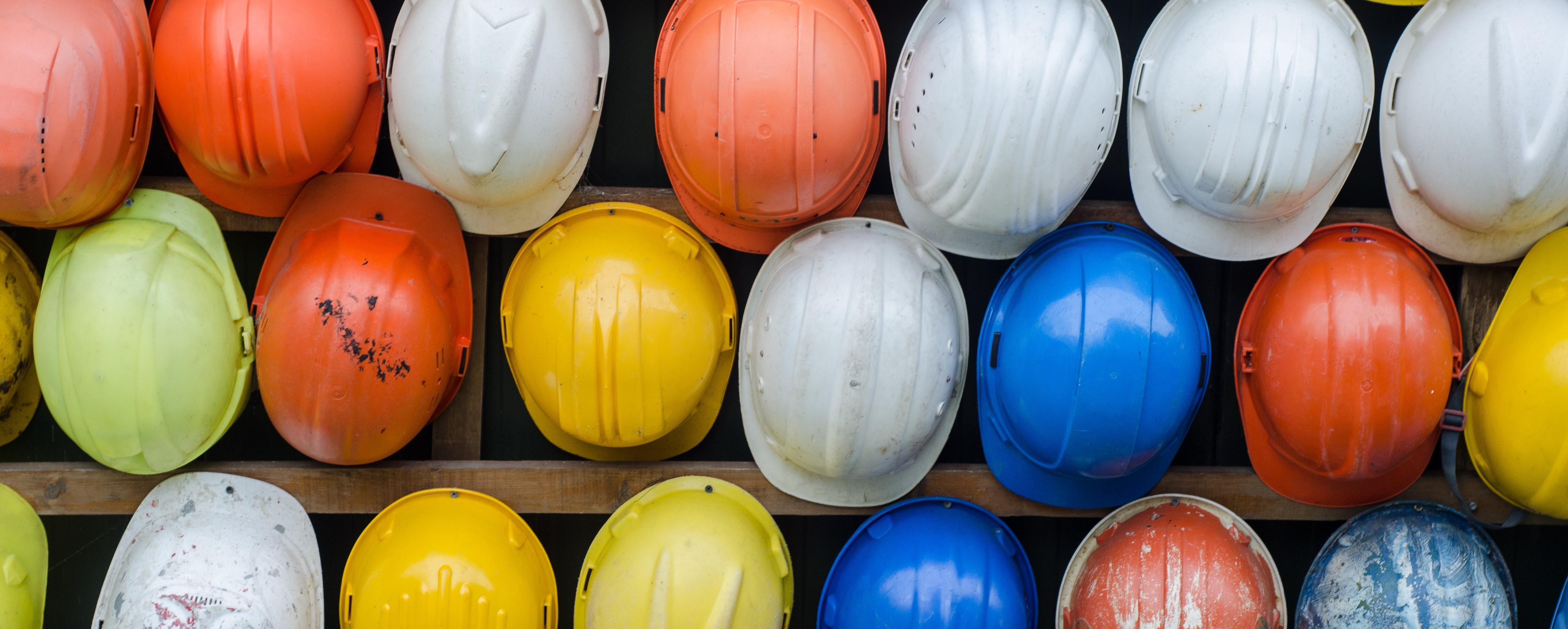 Colorful construction hard hats for demolition.